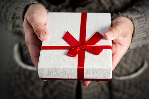 Female hands holding a gift box