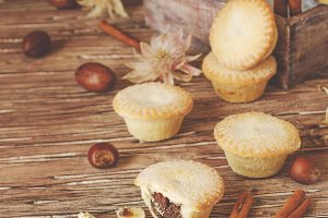 small round Christmas cakes with nuts and cinnamon, space for text