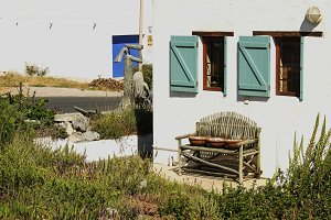 old wooden bench standing next to fishermen's white houses
