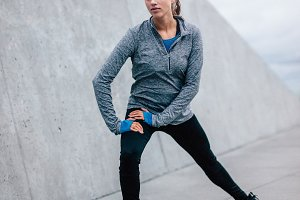 Female runner doing stretches