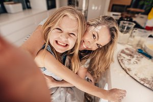 Smiling little girl and woman