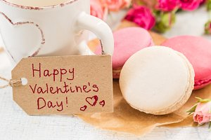 Morning coffee with flowers and macaroons. Mather's day  Valentine'  concept.