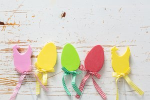 Easter decorations on white wood background