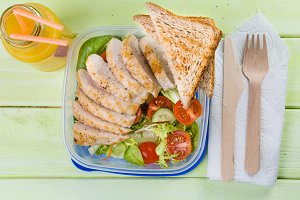 Lunch box with salad and chicken