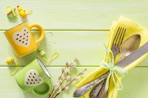 Easter table setting on wood background