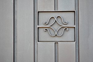 Metal door with ornament