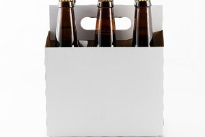 Six bottles of beer in cardboard carrier
