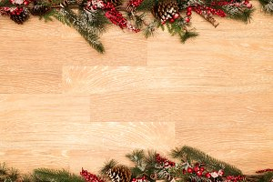 Christmas background on old wood with fir branch