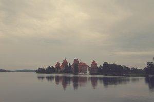 Castle in Gloomy Atmosphere on Lake