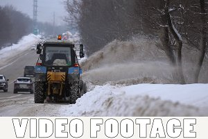 Tractors clean up the snow