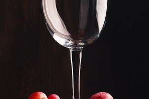 Empty glass for wine and bunch of grapes