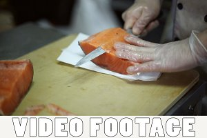 Chef cuts knife a fillet of fish