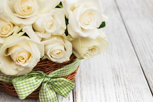 Basket with white roses