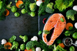 Raw salmon steak and ingredients