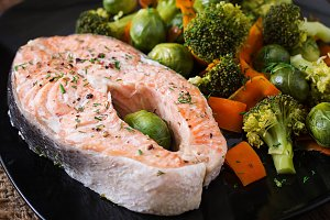 Steam salmon steak with vegetables.