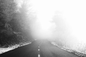 Misty road to the mountains