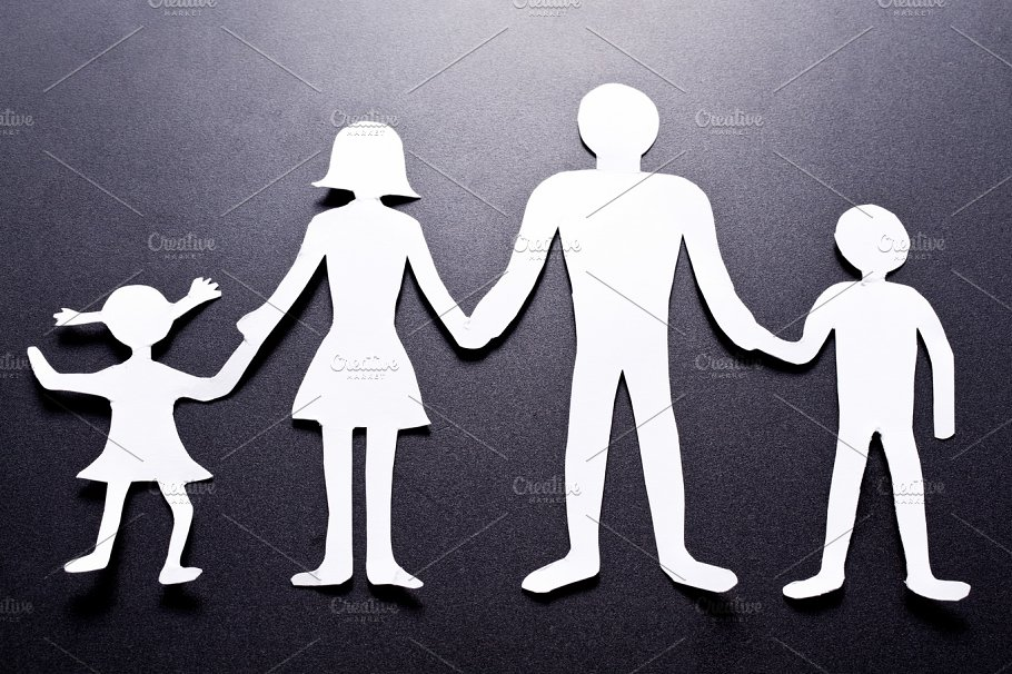 Cardboard Figures Of The Family On A Black Background The Symbol Of