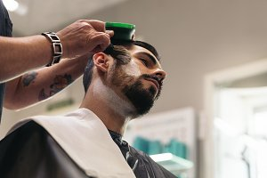 Man Getting Beard Haircut.