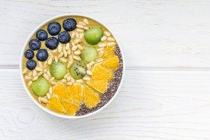 Breakfast smoothie bowl with matcha green tea, kiwi and banana
