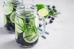 Infused water with fresh blueberry, lime and rosemary, copy space