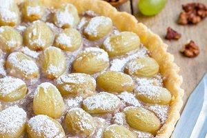 Homemade shortbread dough grape tart with walnut praline, vertical