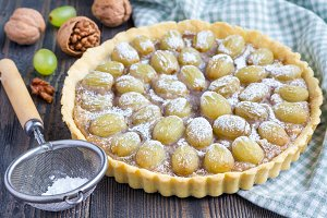 Homemade shortbread dough grape tart with walnut praline, horizontal