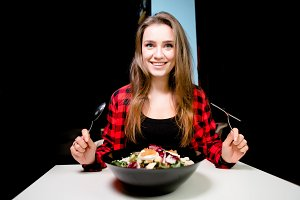 Portrait of pretty girl eating fresh vegetable salad