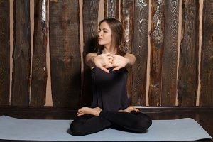 woman is doing yoga exercises