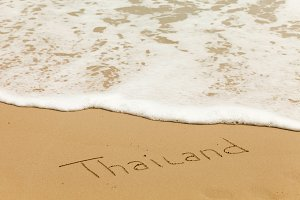 word Thailand in the sand