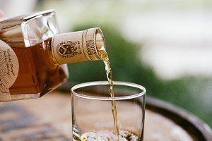 Pouring Bourbon on Barrel
