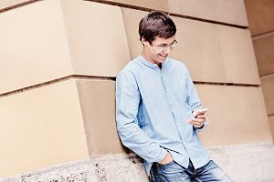 Guy reading on mobile phone
