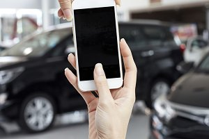 Touch screen mobile phone in hand