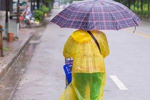 Woman walking in the falling rain.