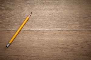 yellow pencil on wooden