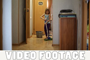 Girl helps parents to do housework