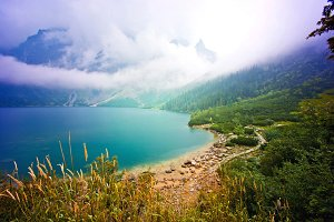 Fog over lake in mountains.