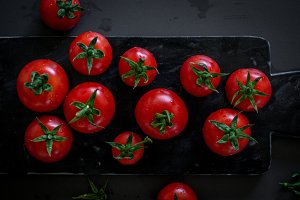 Fresh Tomatoes on black marble