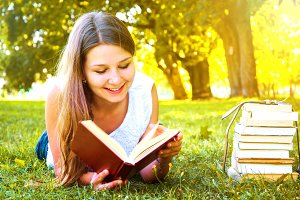 Student girl reading a book.