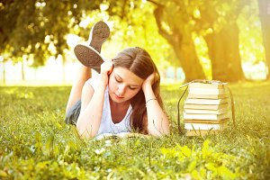 Beautiful girl reading a book.