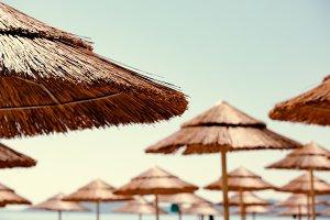 Beach thatched parasols, selective focus. Corfu Island, Greece