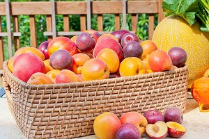 Basket of colorful summer fruits