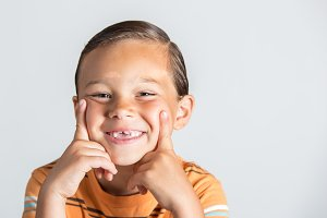 Boy showing missing teeth
