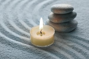 warm candle and cool stone