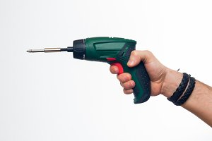 Electric screwdriver in hand
