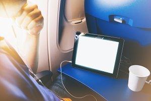 Man uses a tablet in flight