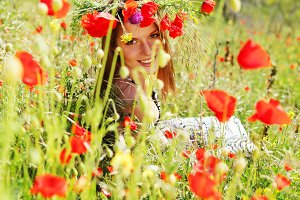 woman in bright red poppy