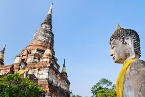 Buddha statue and ancient pagoda