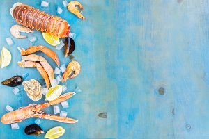Fresh seafood border on blue