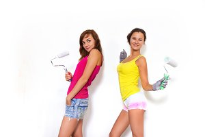 women paints white wall and white paint roller