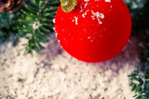 Red bauble and snow Christmas composition